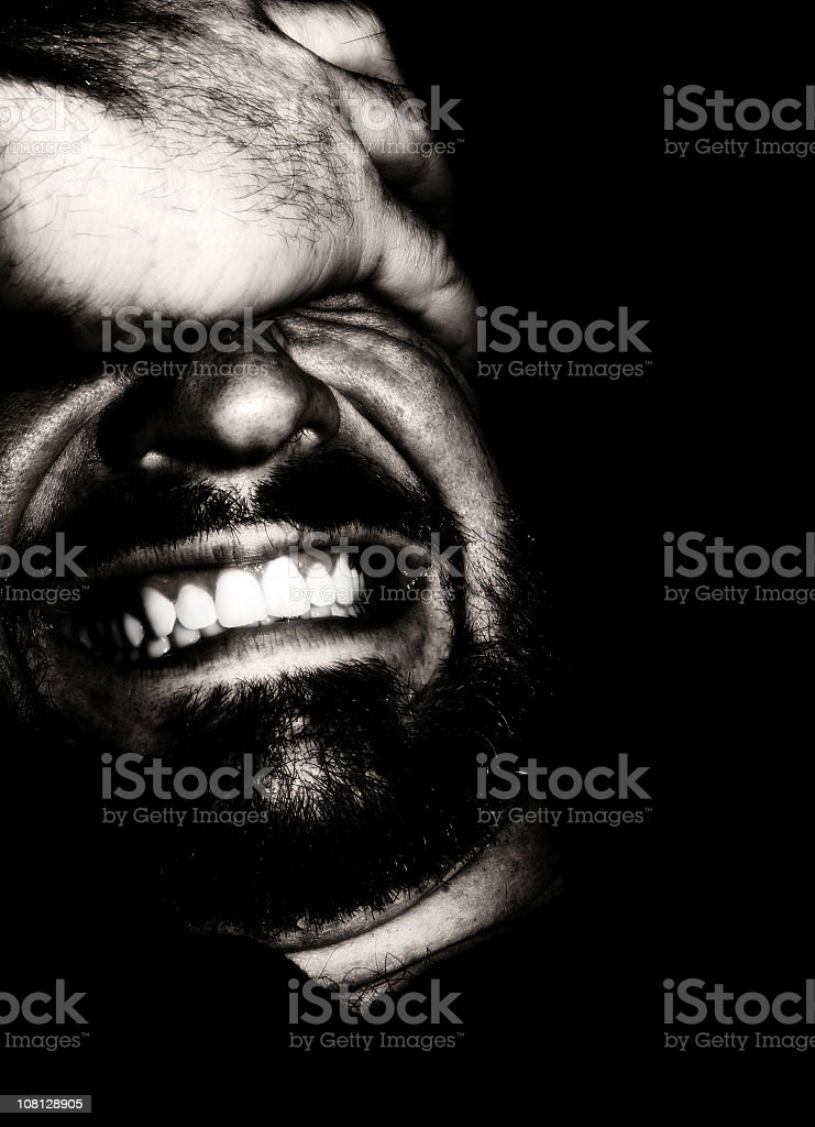Portrait of Man with Facial Expression in Pain, Low Key royalty-free stock photo