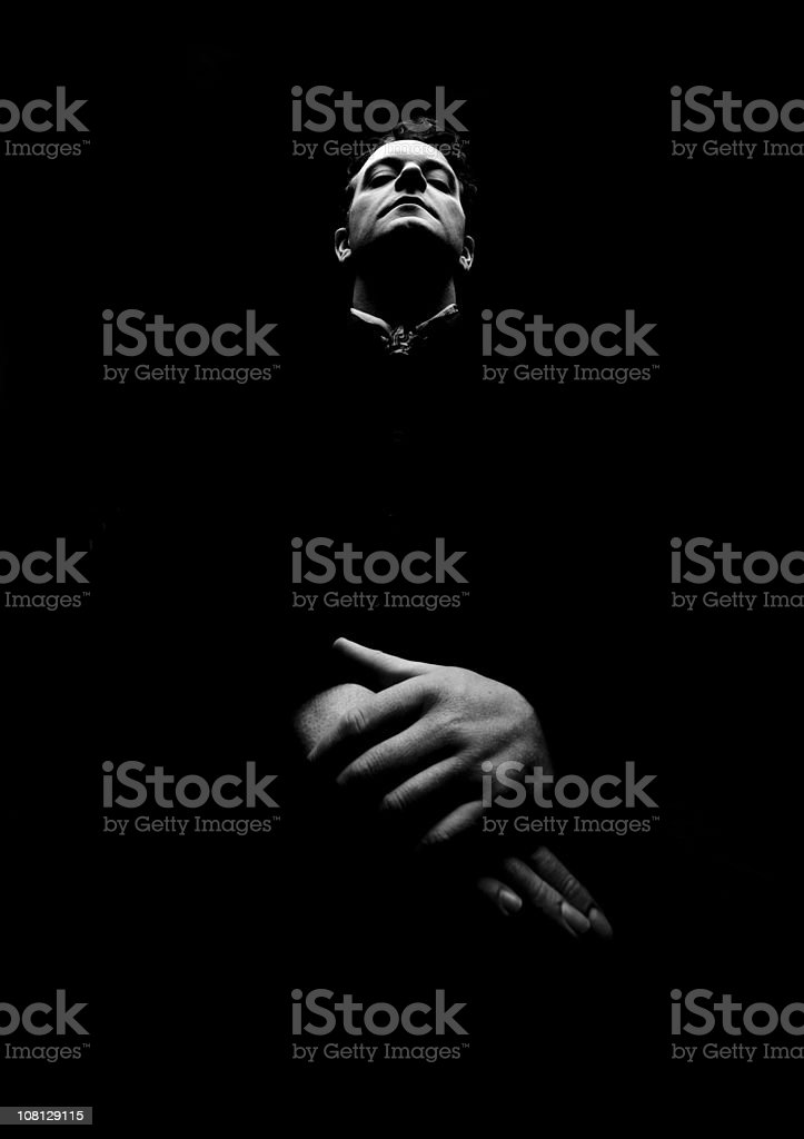 Portrait of Man with Folded Hands, Black and White royalty-free stock photo