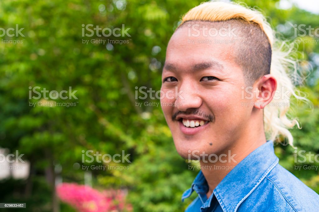 Portrait of man with Iroquois hair style in Tsukuba, Japan stock photo