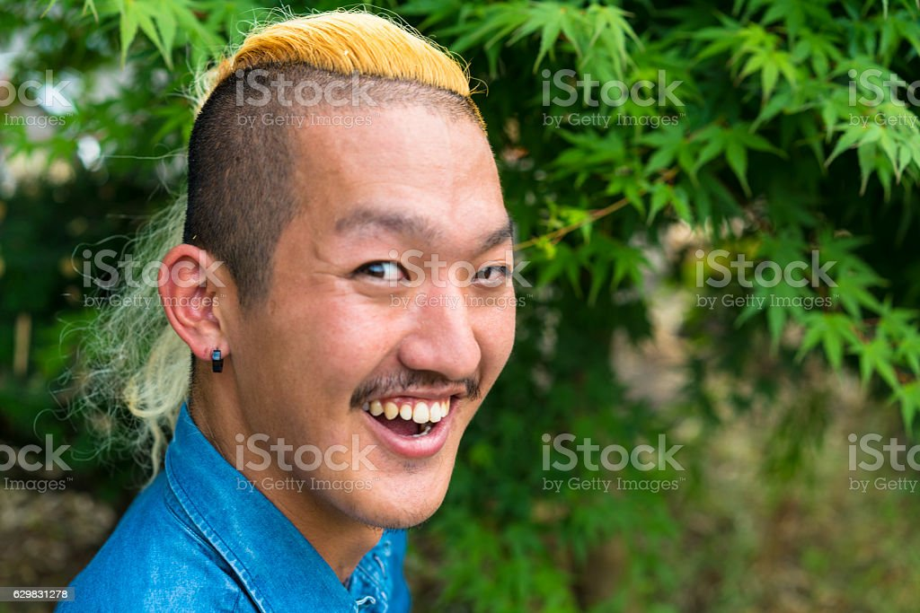 Portrait of man with nice smile and  Iroquois hair style stock photo