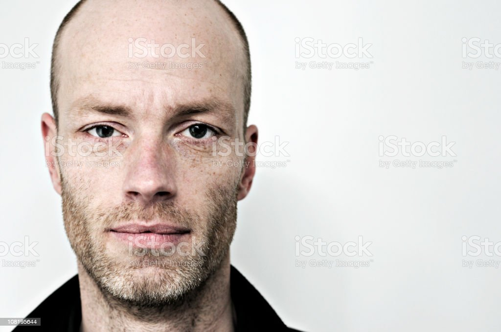 Portrait of Man with Shaved Head royalty-free stock photo