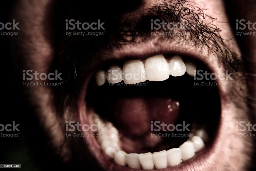 Portrait of Man's Mouth Screaming, Low Key royalty-free stock photo
