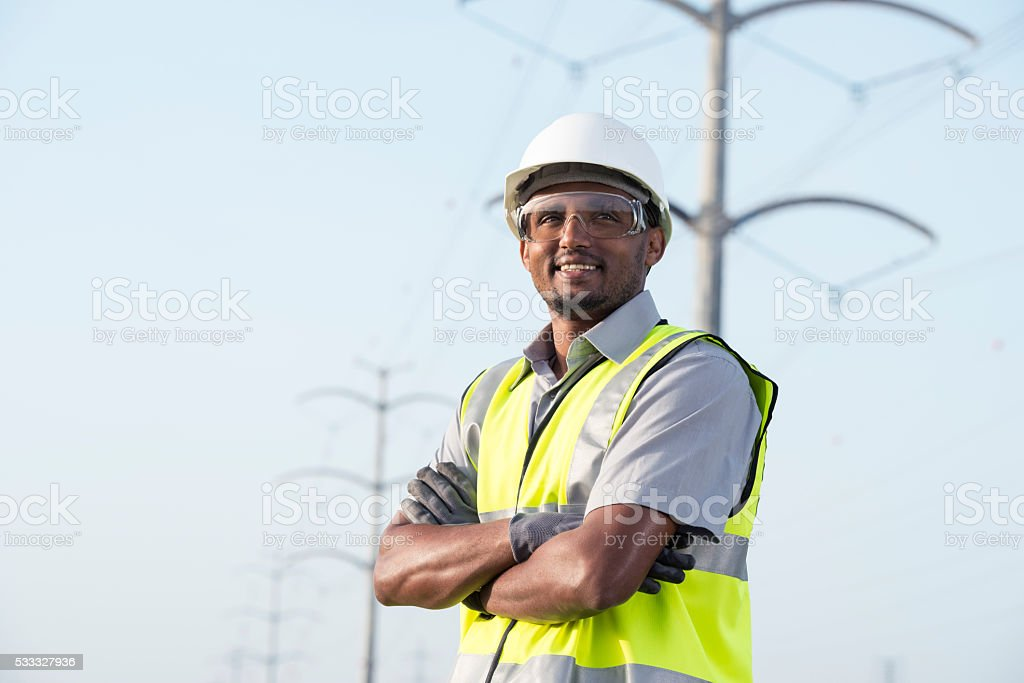 Portrait of manual worker / electrician / lineman / engineer / technician. stock photo