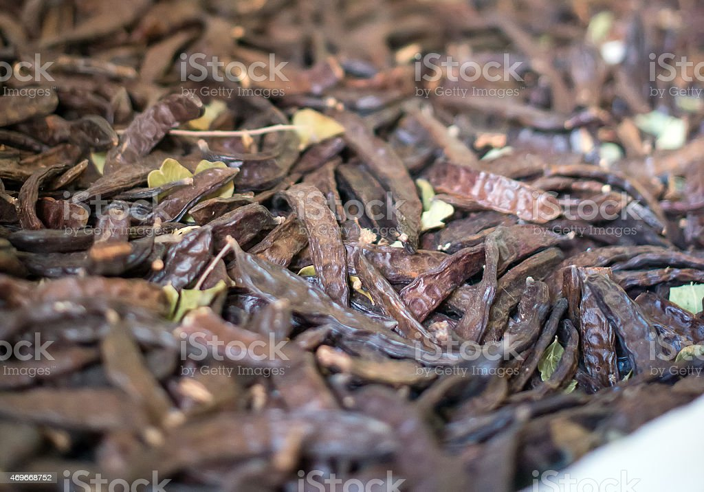 Portrait of many dried carob beans. stock photo