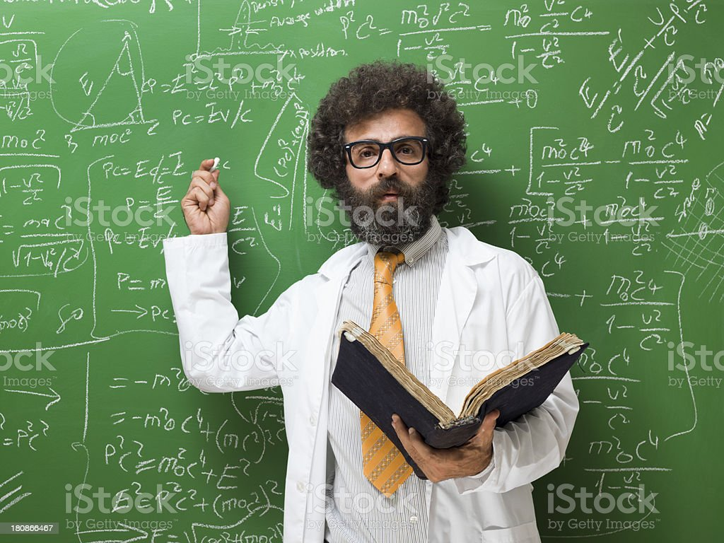 Portrait of mature adult man in lab coat before blackboard royalty-free stock photo
