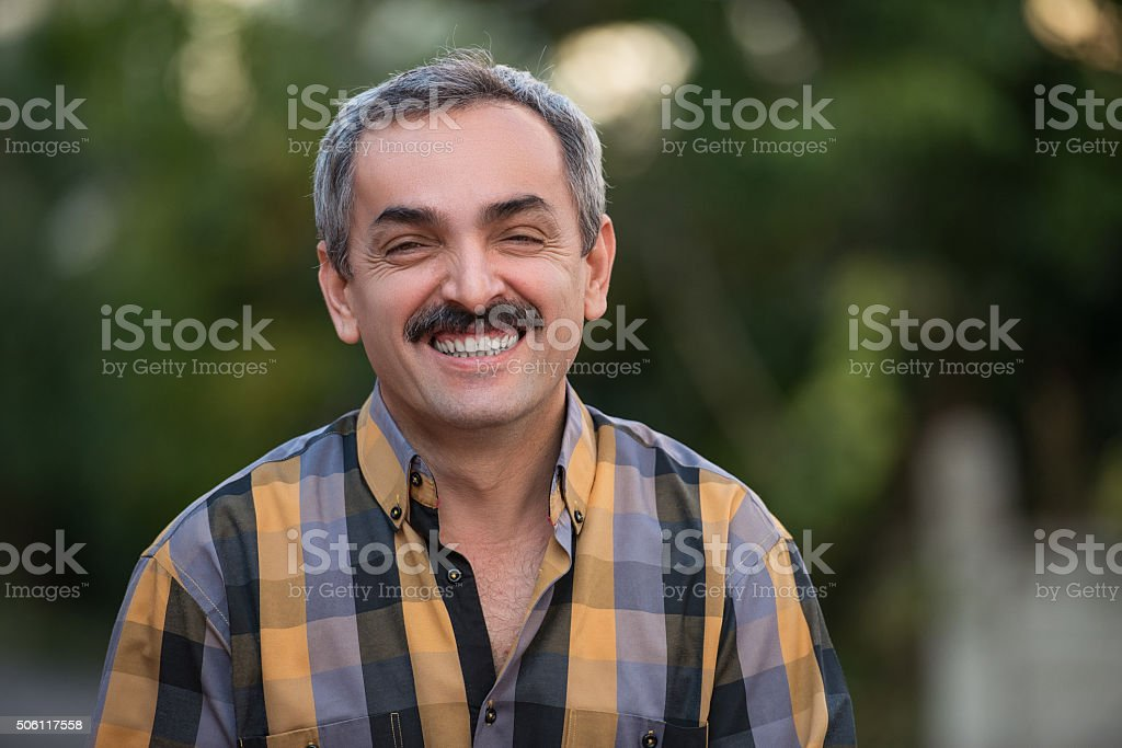 Portrait of mature adult man smiling to camera stock photo