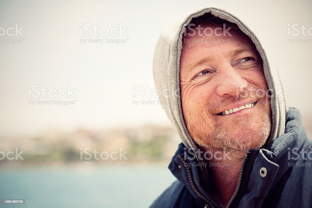 Portrait of mature Australian man in hood stock photo