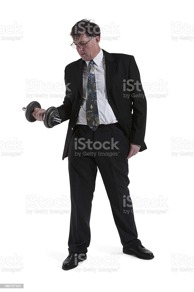 Portrait Of Mature Businessman Lifting Dumbbell royalty-free stock photo