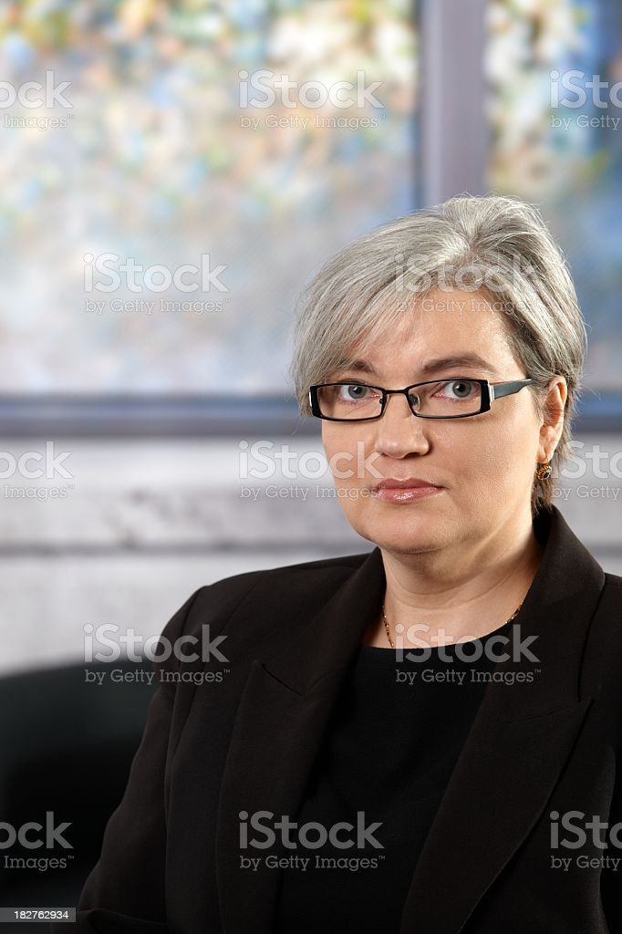 Portrait of mature businesswoman in office royalty-free stock photo
