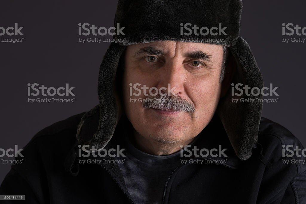 Portrait of mature Caucasian man in fur-cap stock photo