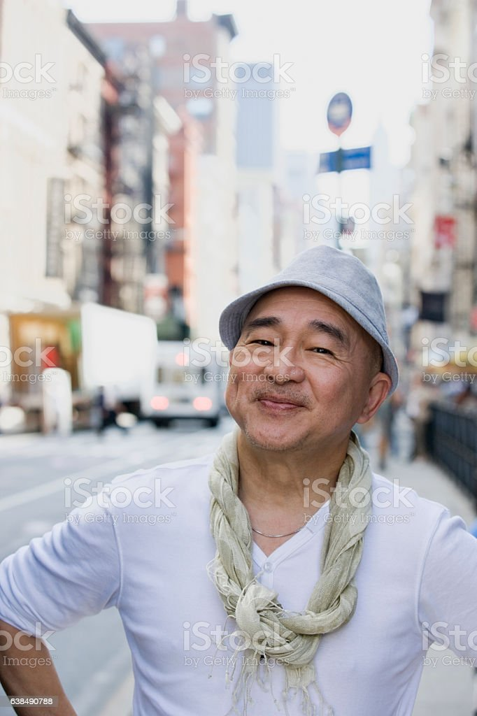 Portrait of mature Chinese man in downtown city stock photo