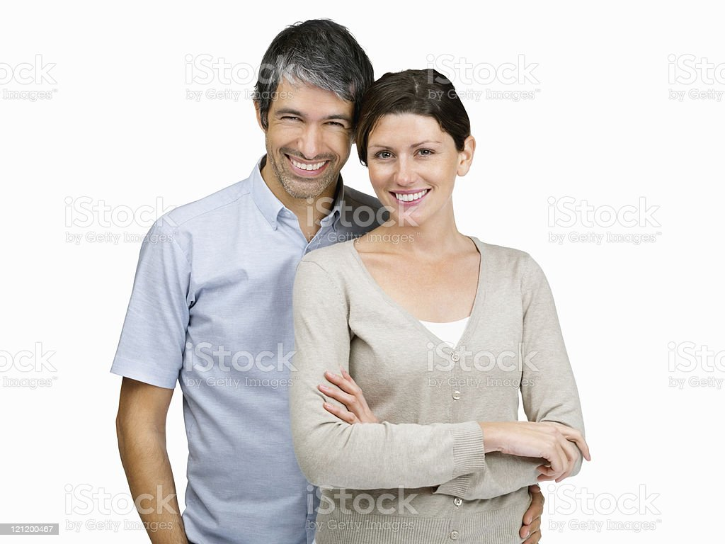 Portrait of  mature couple giving you  warm smile on white royalty-free stock photo