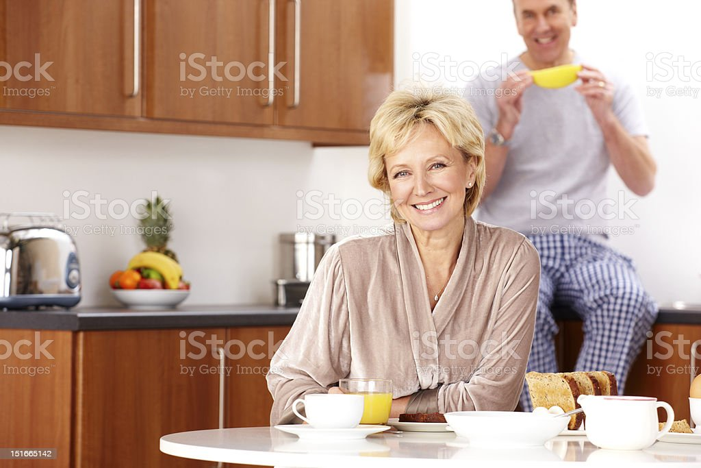 Portrait of mature couple having breakfast at home royalty-free stock photo