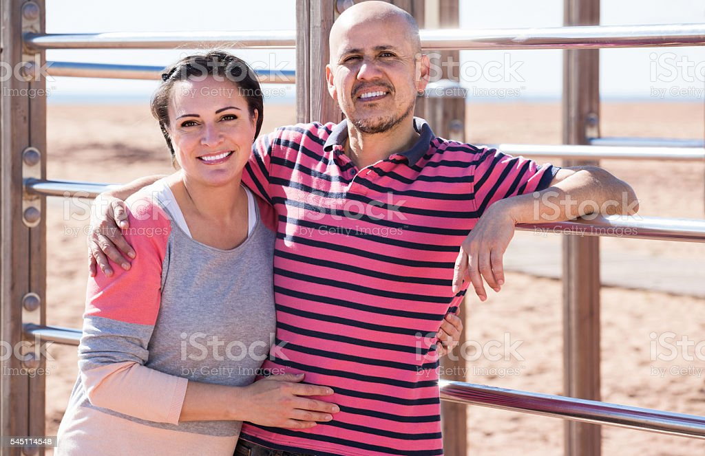 portrait of  mature couple holding each other outdoors stock photo