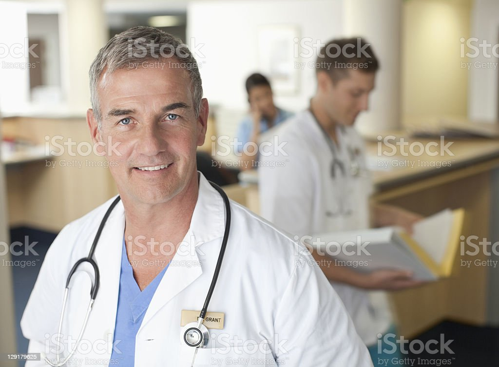 Portrait of mature doctor smiling royalty-free stock photo