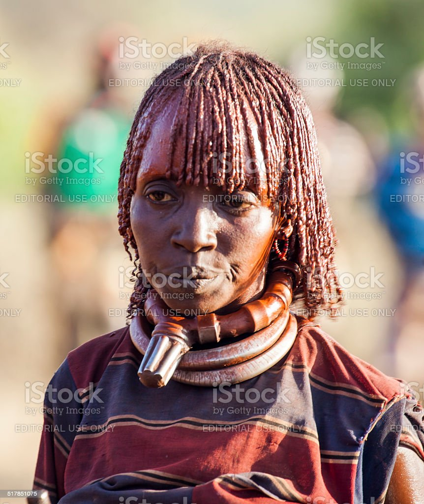 Portrait of mature Hamar woman at bull jumping ceremony. stock photo