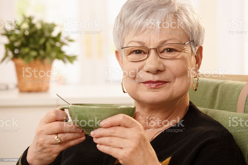Portrait of mature lady with teacup stock photo