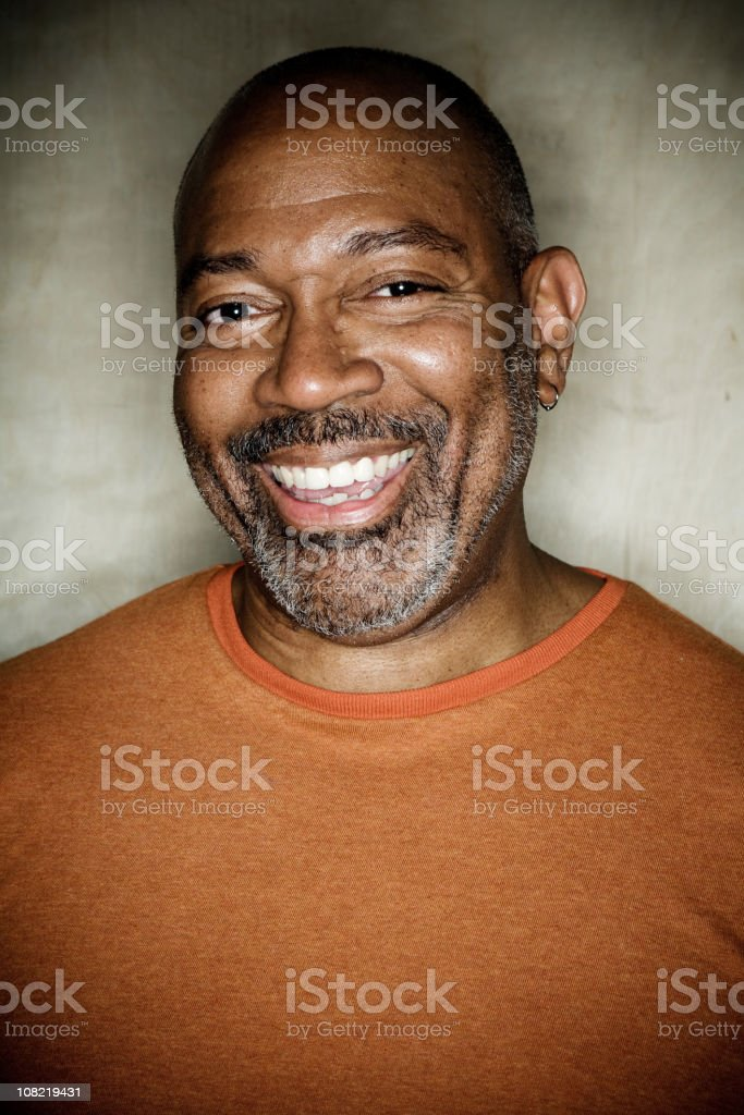 Portrait of Mature Man Smiling and Looking at Camera royalty-free stock photo