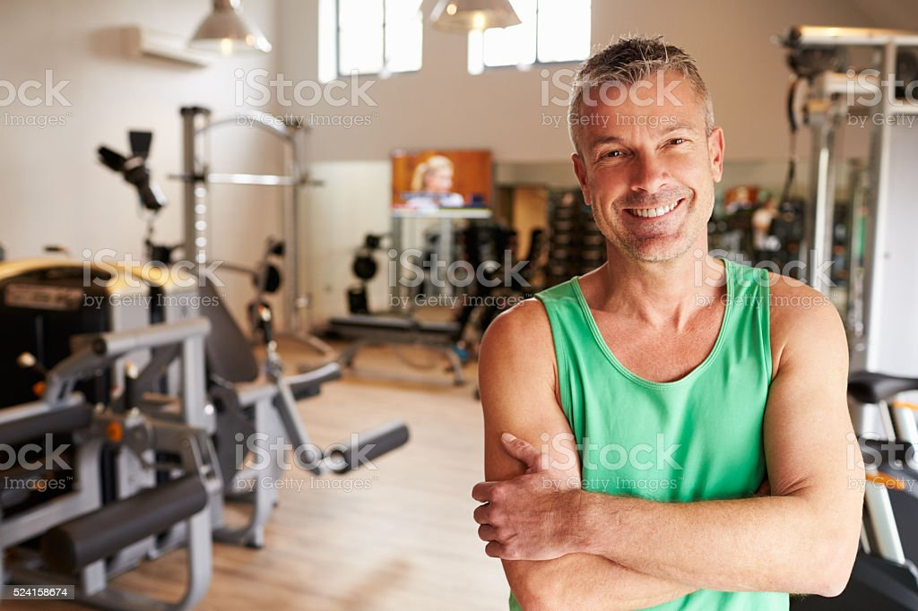 Portrait Of Mature Man Standing In Gym stock photo