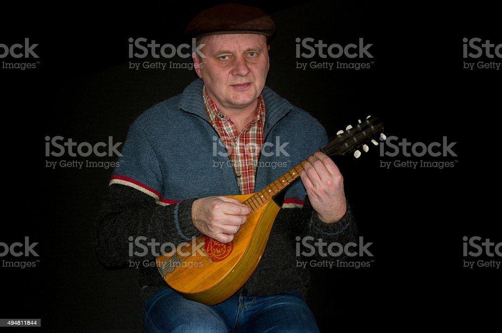 Portrait of mature man with mandolin stock photo