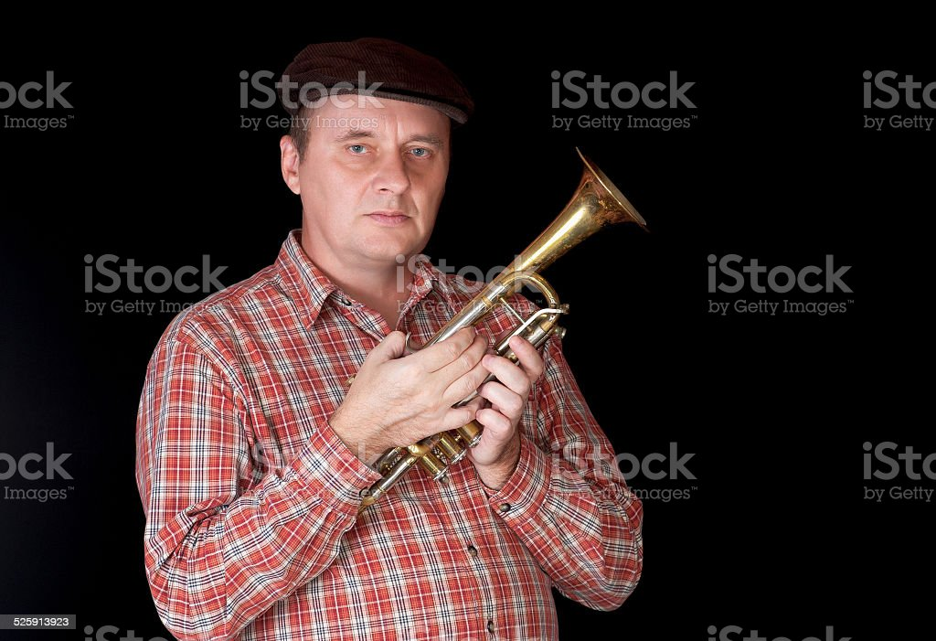 Portrait of mature trumpeter stock photo