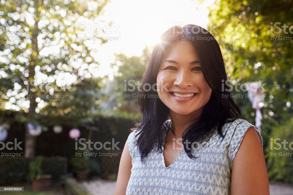 Portrait Of Mature Woman In Back Yard Garden stock photo