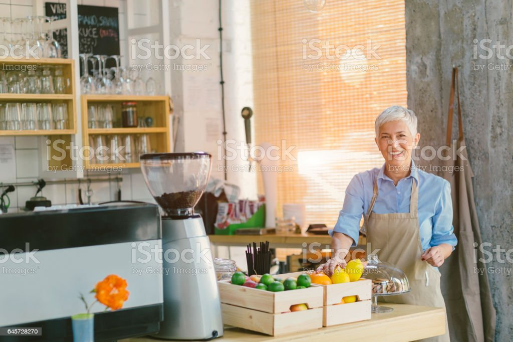 Portrait of Mature Woman Working In Her Smoothie Cafe stock photo