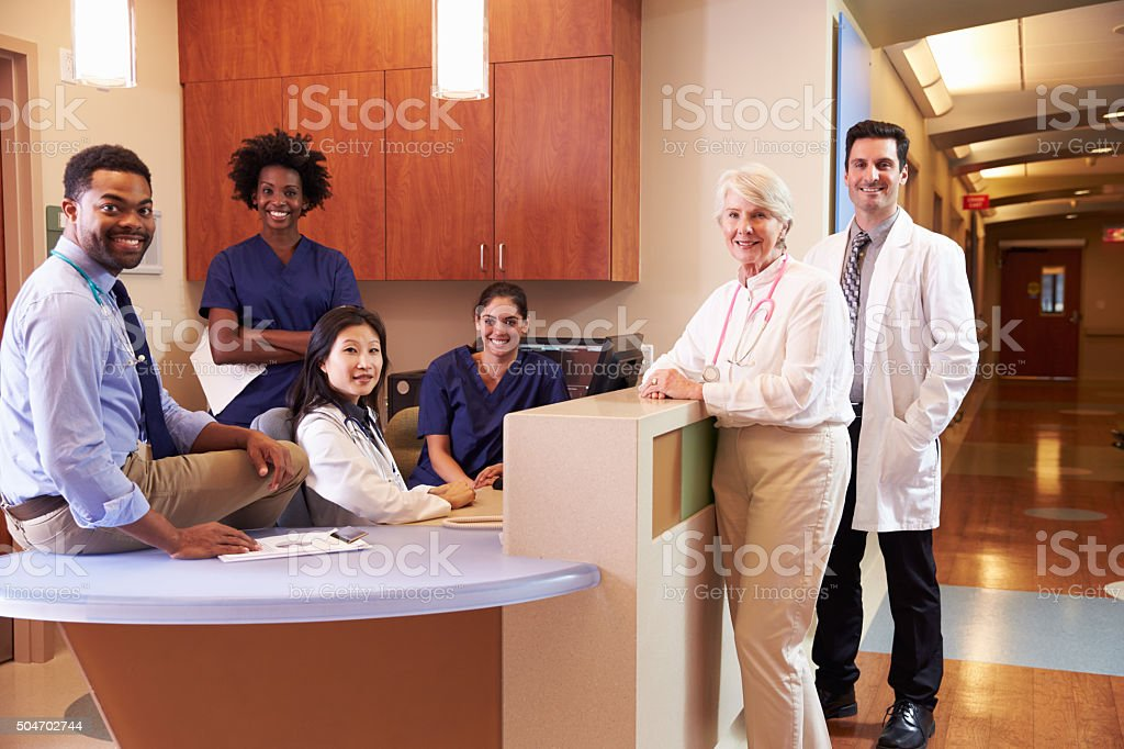 Portrait Of Medical Staff At Nurse's Station In Hospital stock photo
