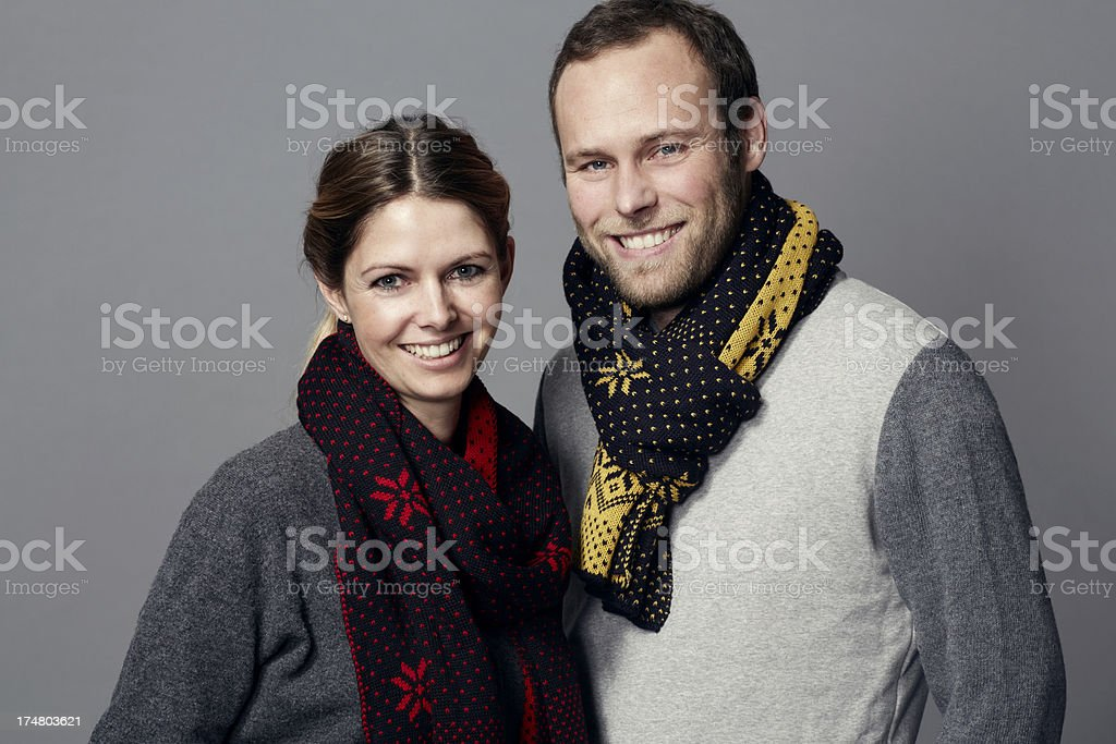 Portrait of mid adult couple wearing scarves royalty-free stock photo
