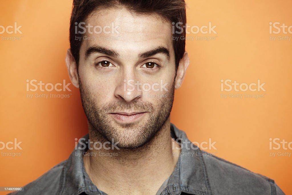 Portrait of mid adult man against orange background royalty-free stock photo