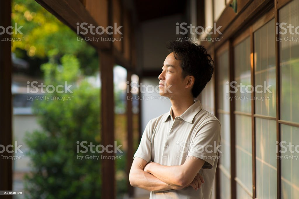 Portrait of Mid adult man in a Japanese temple stock photo