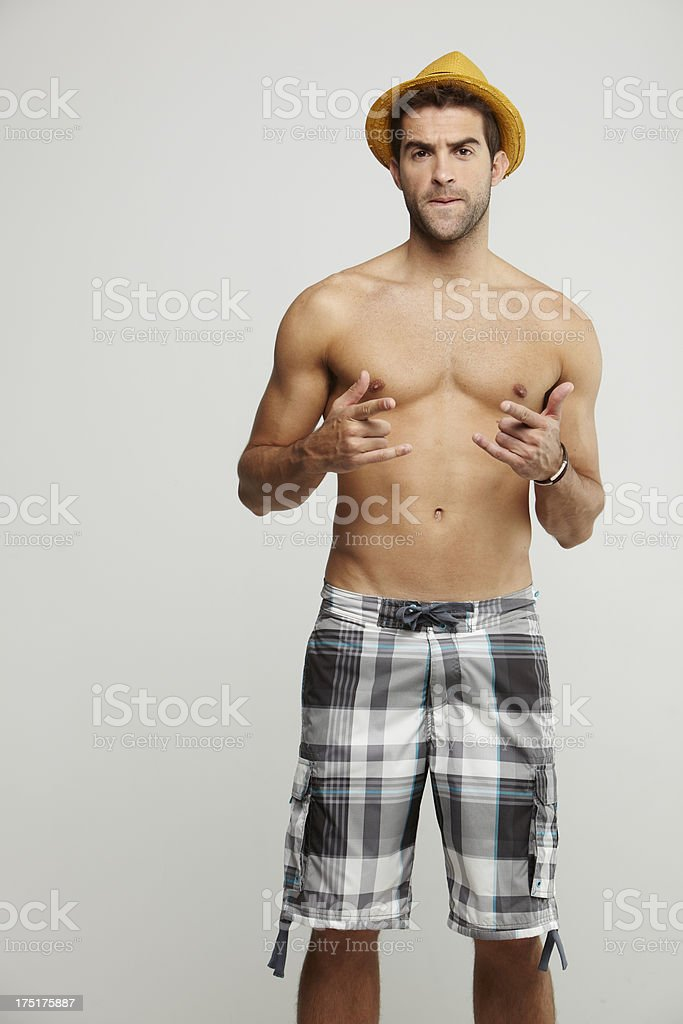 Portrait of mid adult man in shorts, gesturing royalty-free stock photo