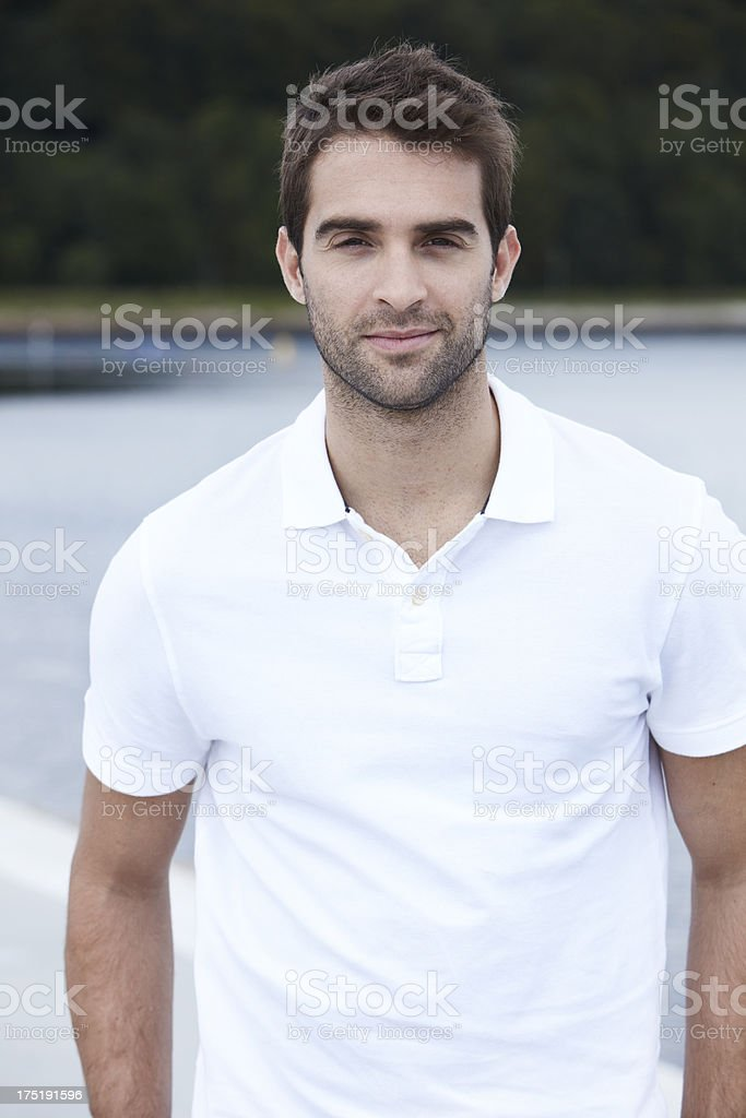 Portrait of mid adult man in white shirt stock photo
