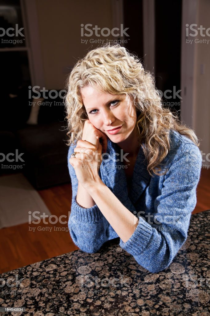 Portrait of mid adult woman at home stock photo
