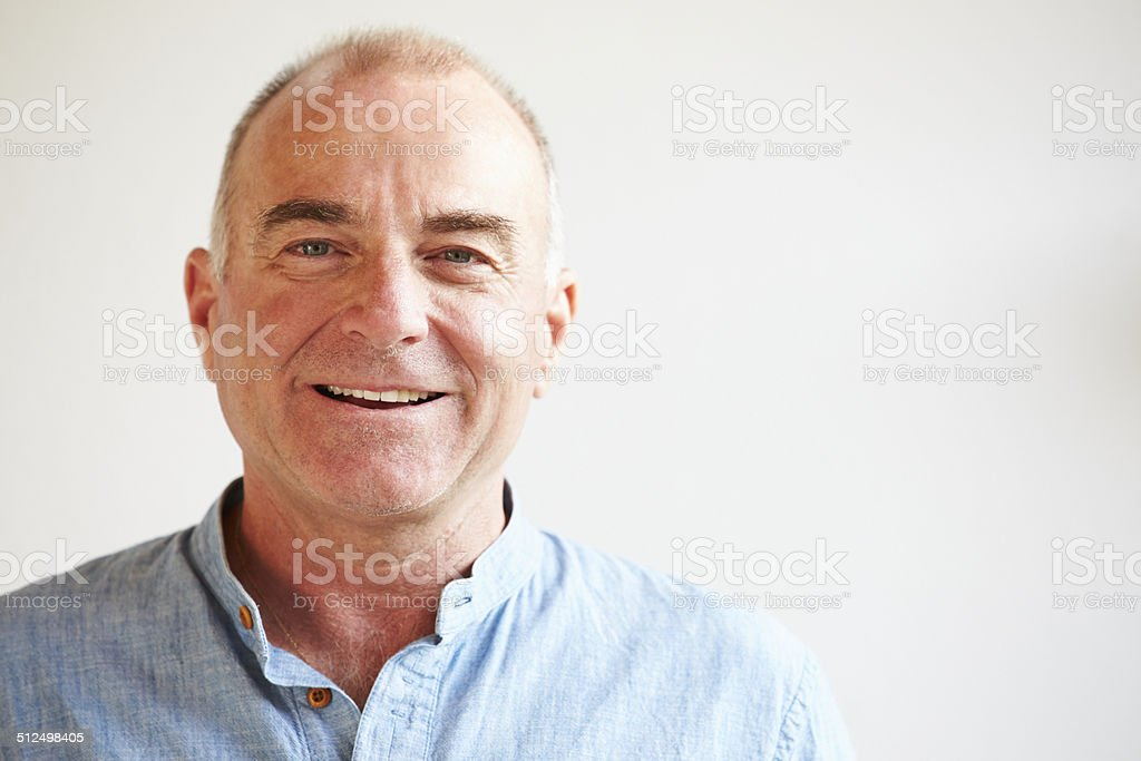 Portrait Of Middle Aged Man Standing By Wall stock photo