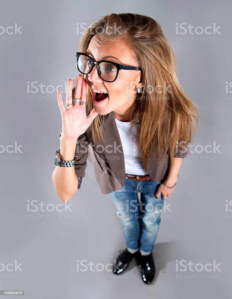 portrait of middle aged woman shouting using megaphone stock photo