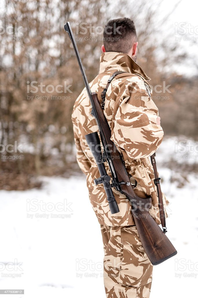 Portrait of military army man carrying sniper rifle stock photo