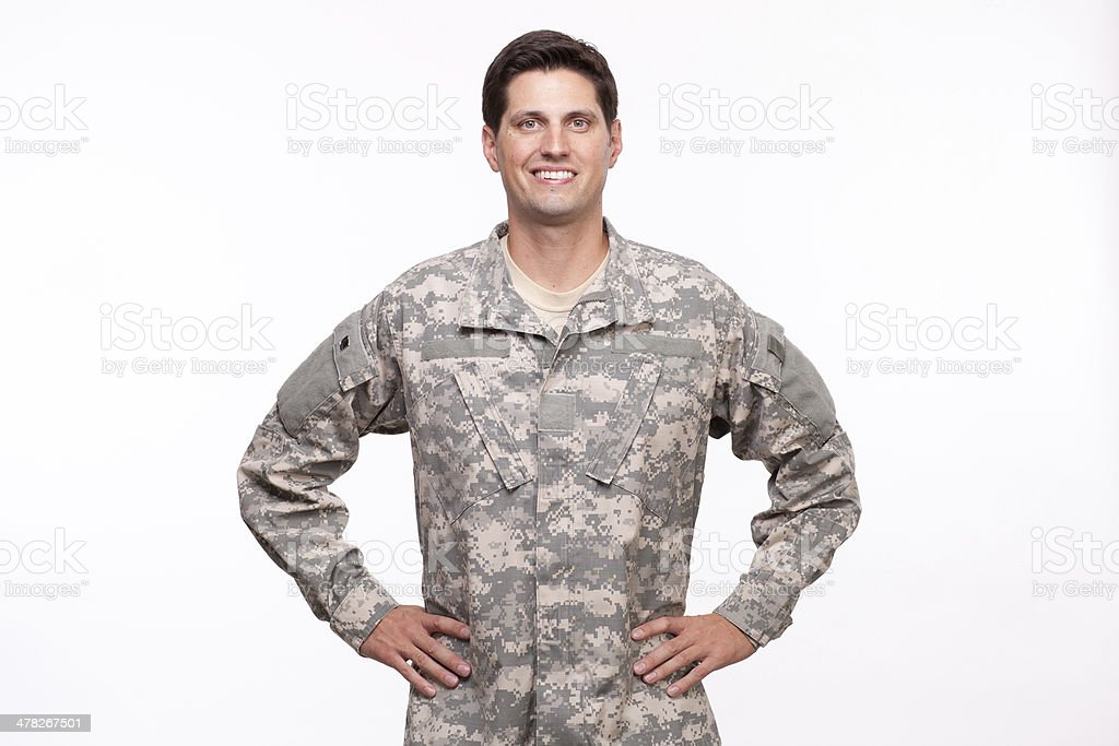 Portrait of military serviceman posing with hands on hips royalty-free stock photo