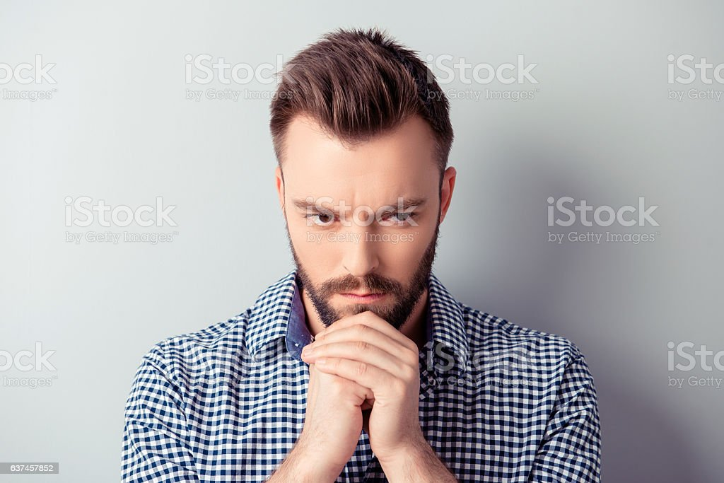 Portrait of minded man waiting for special moment and praying stock photo