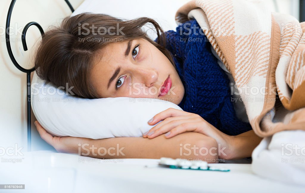 Portrait of miserable girl wth flu at home stock photo