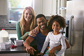 Portrait of mixed race couple and daughter in the kitchen