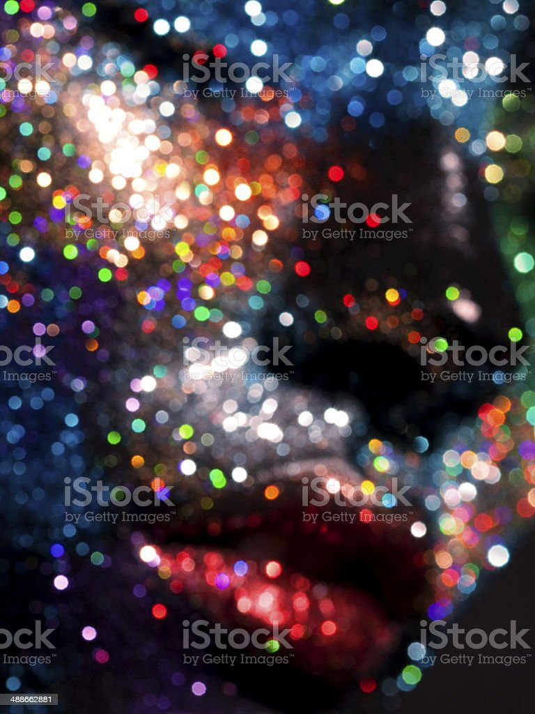 Portrait of model in studio with bright makup with sequins royalty-free stock photo