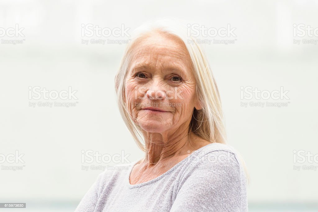 Portrait of modern attractive blond mature woman, copy space stock photo