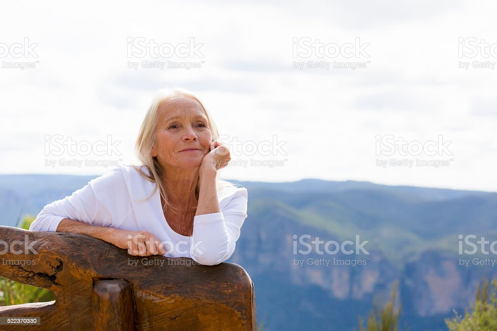 Portrait of modern attractive mature woman outdoor, copy space stock photo