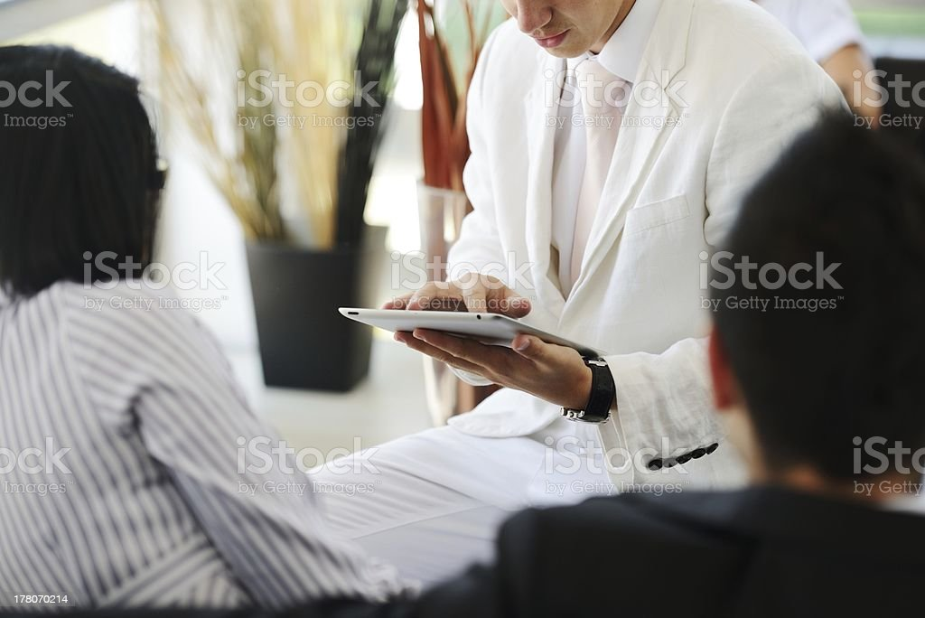 Portrait of modern couple talking to manager while discussing co royalty-free stock photo
