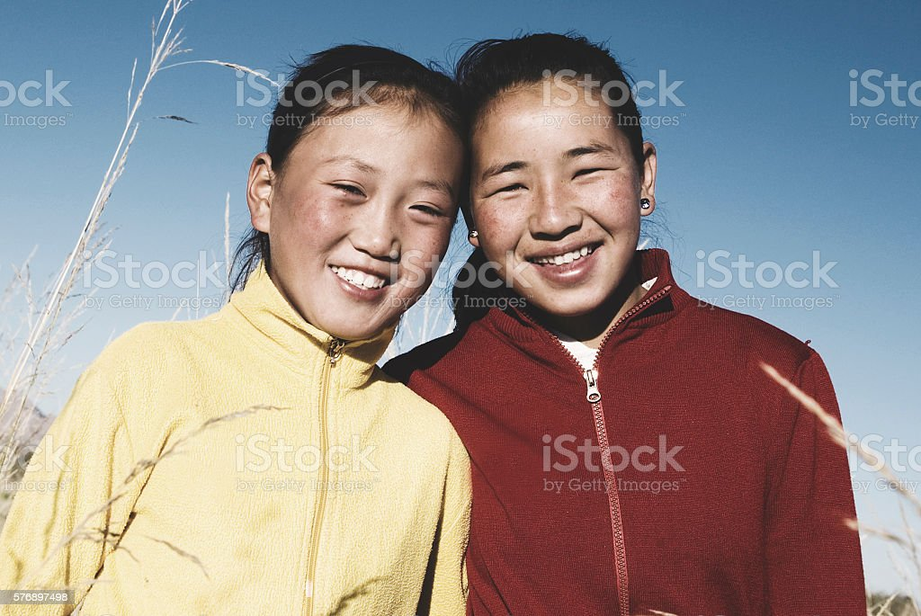 Portrait of Mongolian Two Sisters with Beautiful Smiling Concept stock photo