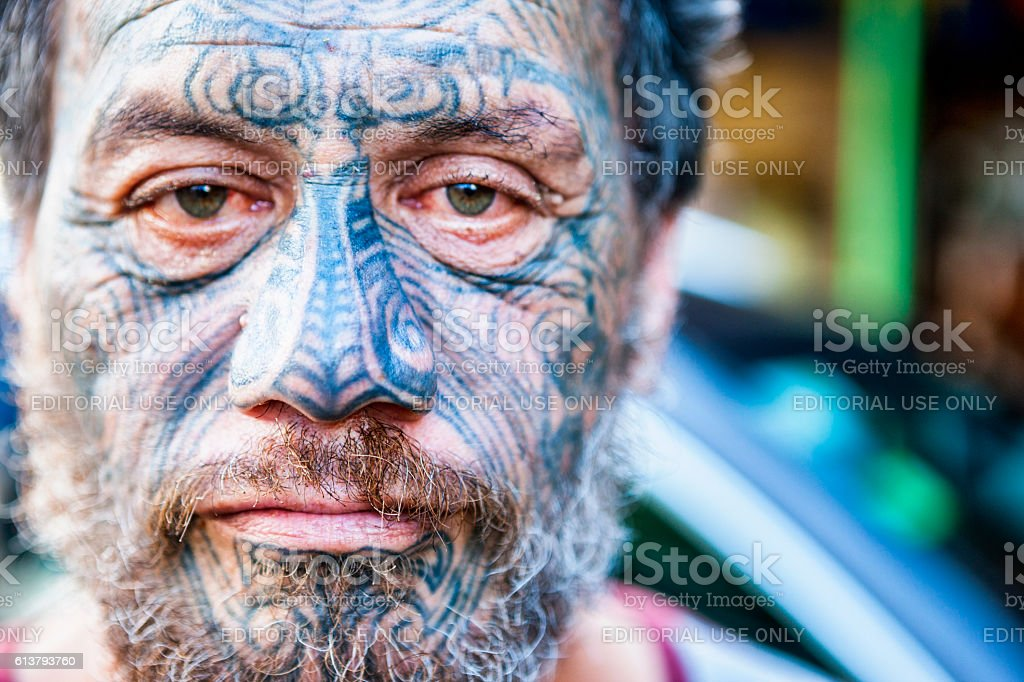 Portrait of Māori man with traditional Tā moko face tattoos stock photo