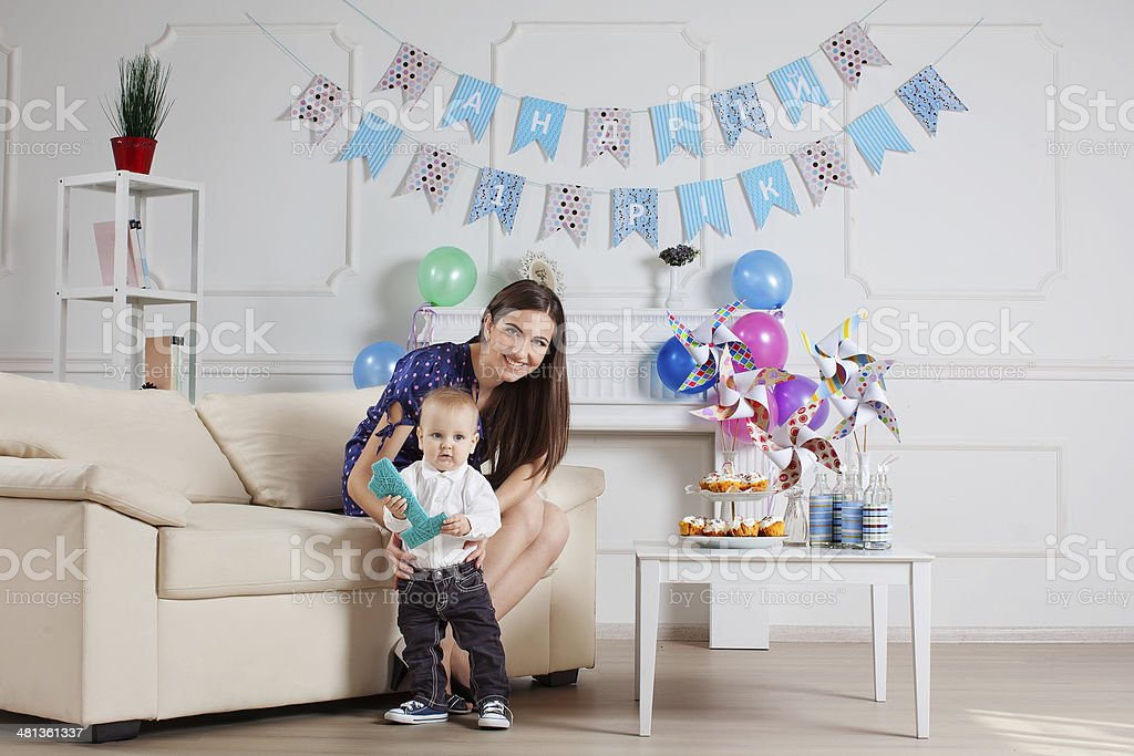 Portrait of mother and baby with birthday cake stock photo
