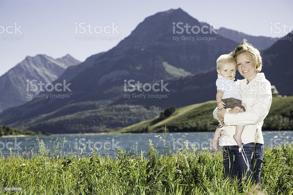 Portrait of Mother and Child Near Mountain Lake royalty-free stock photo