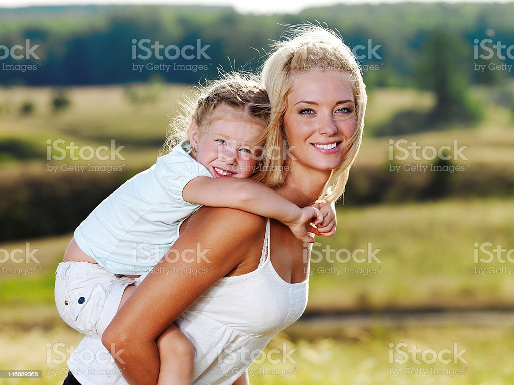 Portrait of  mother and little pretty girl outdoors royalty-free stock photo